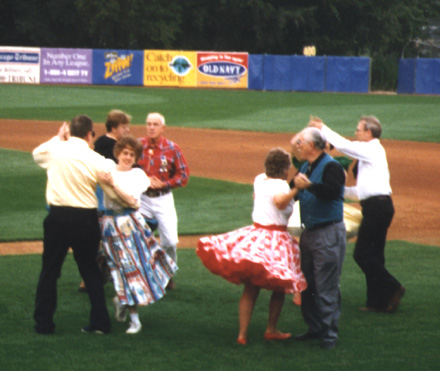 Square Dancing on the field before Kane County Cougars Baseball Game
